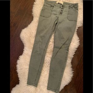 Button front olive skinnies